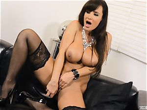 Lisa Ann pushes her faux-cock deep in her raw cunny