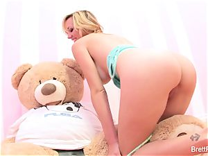 Brett Rossi plays with a tucked bear's strap-on fuck stick