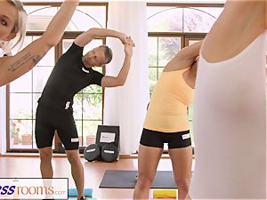 FitnessRooms sweat-soaked cleavage in a room full yoga honeys