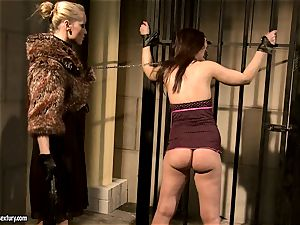 Kathia Nobili in furry jacket tormenting a scorching babe