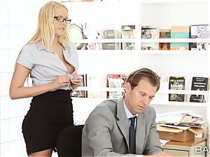 Vanessa cell leans over the desk and takes her bosses pipe
