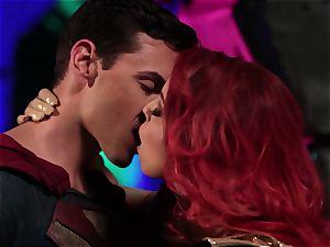 Britney Amber sucks off a ultra-kinky superhero