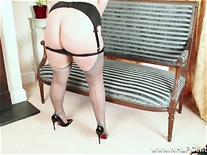 curvaceous blondie masturbates in grey nylons and high high-heeled slippers